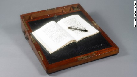 Portable writing desk that belonged to Jane Austen. Open book and spectacles.