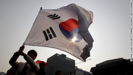 SEOUL, SOUTH KOREA - FEBRUARY 22:  A South Korean student waves a national flag during an anti-Japan rally on February 22, 2014 in Seoul, South Korea. South Korea and Japan are making claim to a set of islands controlled by South Korea, Dokdo or Takeshima, located in the East Sea. The rally was taking place after the Japanese government declared today to be Takeshima Day, further fueling a long-standing territorial row between the two countries.  (Photo by Chung Sung-Jun/Getty Images)