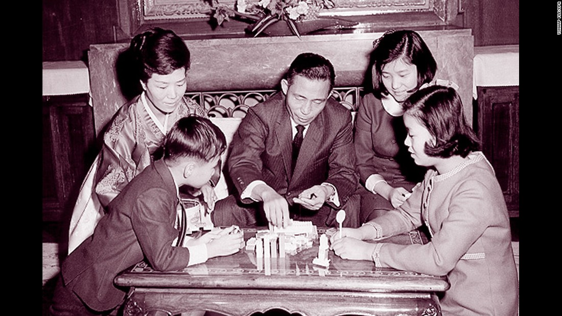In this undated photo, Park is seen at back right with her late father, former South Korean President Park Chung-hee; her mother, Yook Young-soo; her sister, Park Geun-young; and her brother, Park Ji-man. Her father seized power in a military coup in 1961. He rewrote the constitution to cement his grip on power and brutally cracked down on dissent and opposition, leading many to call him a dictator.