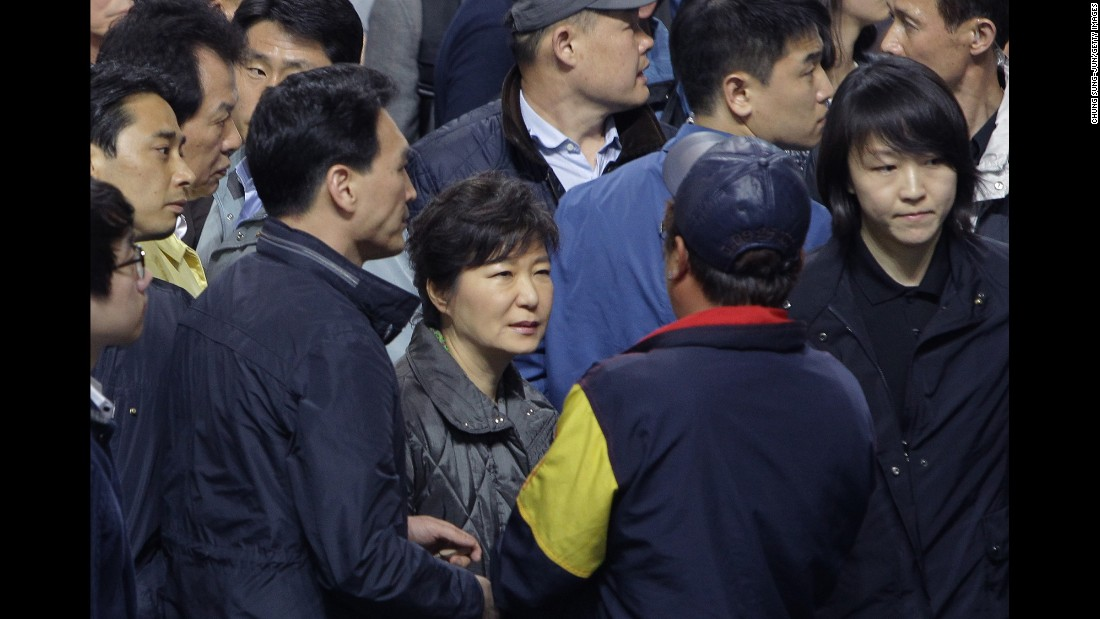 Park talks with families of missing passengers after the Sewol ferry disaster in April 2014. The passenger ferry sank a day earlier, killing 304 people. Most of those aboard were high school students on a field trip to Jeju island, off South Korea's southern coast.