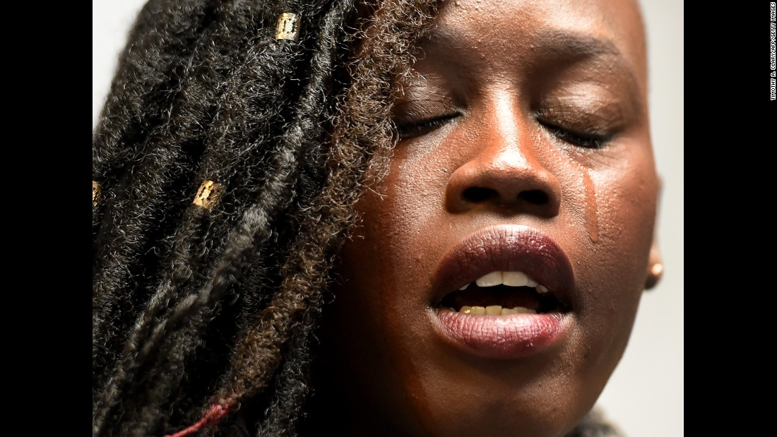 "Elizabeth Arjok, a Sudanese immigrant, sheds a tear Monday, March 6, as she speaks before the start of a news conference by the New York Immigration Coalition. <a href=""http://www.cnn.com/2017/03/06/politics/trump-travel-ban-iraq/index.html"" target=""_blank"">A revised travel ban</a> was signed earlier that day by US President Donald Trump. The executive order, which temporarily stops immigration from six countries and reinstates a ban on all refugees, ""breaks my heart,"" Arjok said at the news conference. She fled the war in Sudan when she was 7, <a href=""http://www.wnyc.org/story/3-stories-new-yorkers-affected/"" target=""_blank"">according to radio station WNYC.</a>"