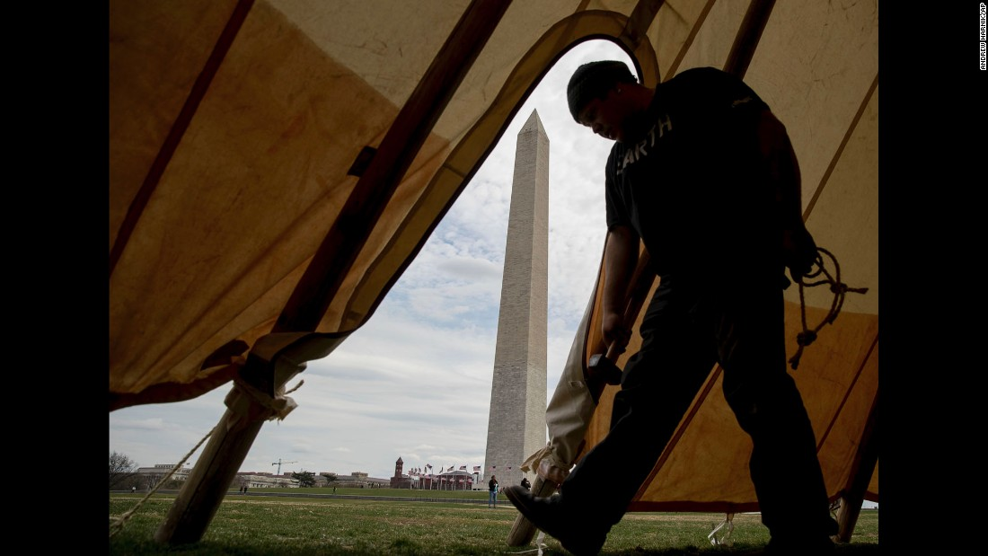 Aldo Seoane helps set up teepees near the Washington Monument on Tuesday, March 7. He was with a group of Native Americans protesting construction of the Dakota Access Pipeline.
