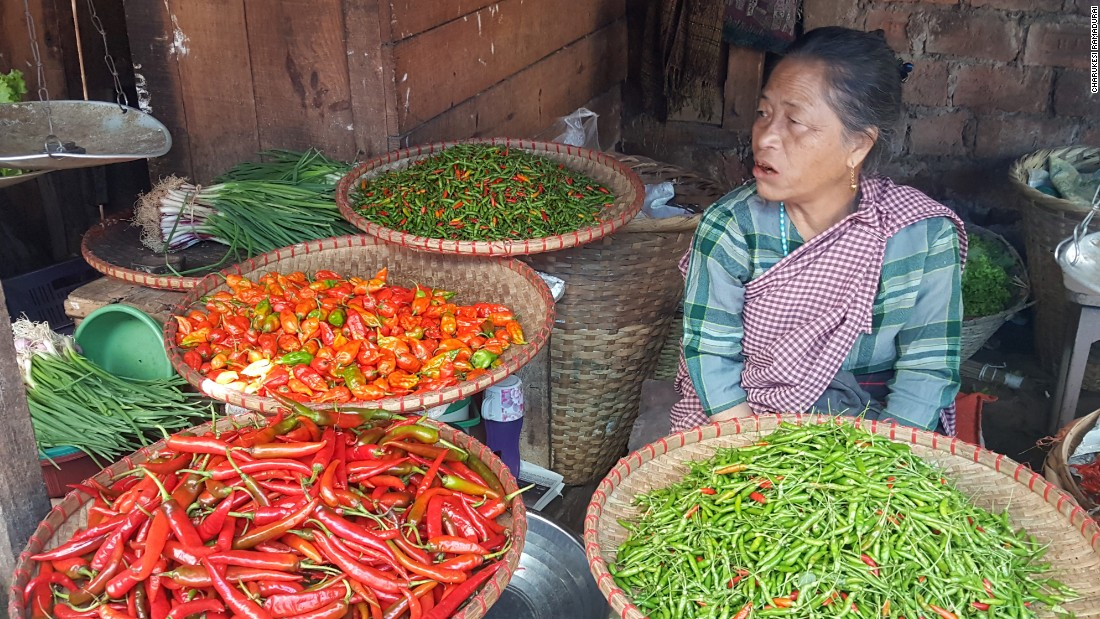 <strong>Bara Bazaar, Shillong: </strong>Vendors hawk fresh chicken, pork, and vegetables -- including dozens of varieties of chili peppers.