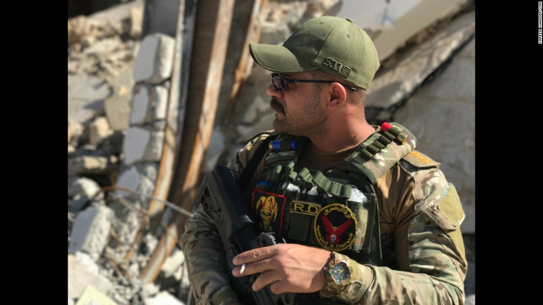 An Iraqi Rapid Response officer takes a break inside western Mosul's Dawasa neighborhood. Iraqi forces have made big advances inside western Mosul and liberated many of the neighborhoods there since launching an offensive to retake that part of the city last month. ISIS seized Mosul in June 2014.
