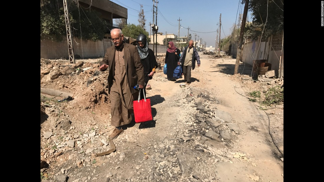 A family from western Mosul flees on foot with the few belongings they were able to carry with them. More than 57,000 people have been displaced since Iraqi forces moved to retake the western part of the city last month, according to the United Nations.