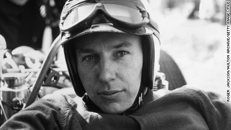 John Surtees, British Formula One driver, wearing his crash hemlet, with his goggles raised, at the Race of Champions meeting at Brands Hatch near Swanley in Kent, England, United Kingdom, in March 1965. Having won the Formula One World Championship in 1964 and the 500cc motorcycle World Championship in 1956, 1958, 1959 and 1960, Surtees is the only person to have won World Championships on both two and four wheels. (Photo by Roger Jackson/Central Press/Hulton Archive/Getty Images)