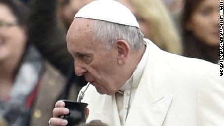 "Pope Francis (L) takes a sip of ""mate"", a traditional Argentinian drink, offered by a pilgrim during his weekly general audience in St Peter's square on November 18, 2015 at the Vatican.  AFP PHOTO / ANDREAS SOLARO        (Photo credit should read ANDREAS SOLARO/AFP/Getty Images)"