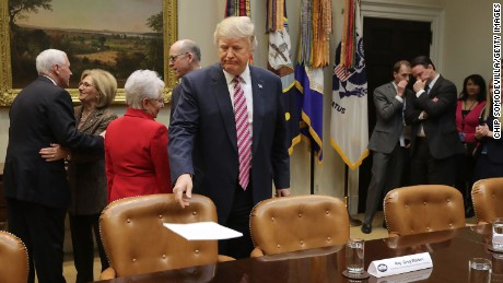 WASHINGTON, DC - MARCH 10:  U.S. President Donald Trump sets down his remarks before meeting with House of Representatives committee leaders to discuss the American Health Care Act in the Roosevelt Room at the White House March 10, 2017 in Washington, DC. The proposed legislation is the Republican attempt to repeal and replace Obamacare.  (Photo by Chip Somodevilla/Getty Images)