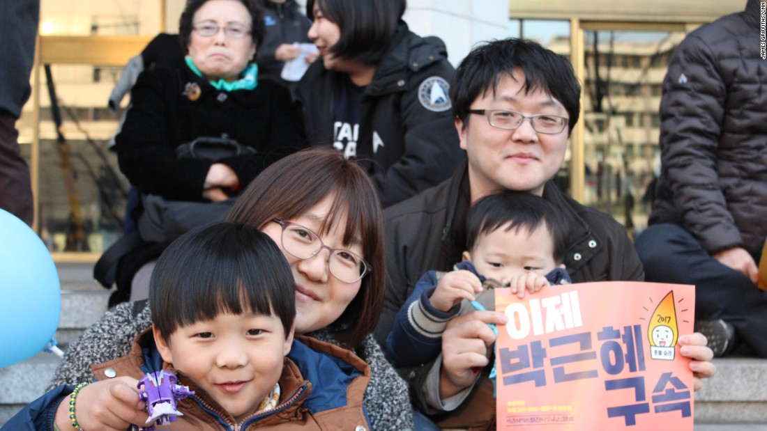 "Lee Dong-sun, 36, brought her children to the demonstration celebrating Park's impeachment. ""Before, when there were other protests, I would just sit at home, even when I agreed,"" she said. ""But after I had children, I felt I could no longer ride on the backs of others ... to bring them the future I desire."""