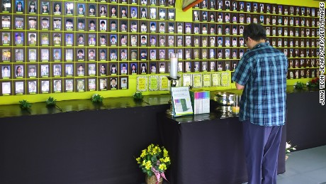 A man prays in front of portraits of the victims of South Korea's Sewol ferry disaster at a memorial altar in Seoul's Gwanghwamun Square.