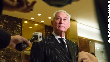 Conservative lobbyist and consultant Roger Stone speaks with the press in the lobby of Trump Tower in New York, New York, following a meeting there on December 6, 2016.