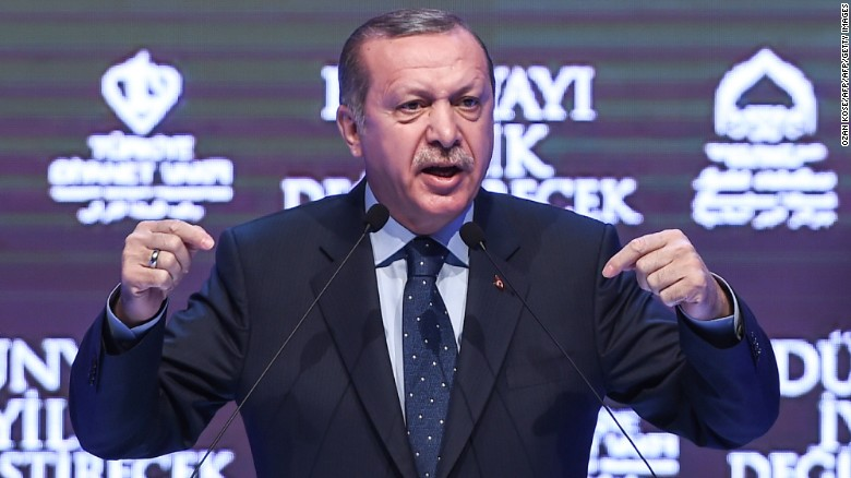 "Turkish President Recep Tayyip Erdogan gestures as he speaks in Istanbul on March 12, 2017. Turkey's President Recep Tayyip Erdogan on March 12 threatened that the Netherlands would ""pay a price"" after expelling a Turkish minister from the country. / AFP PHOTO / OZAN KOSE        (Photo credit should read OZAN KOSE/AFP/Getty Images)"
