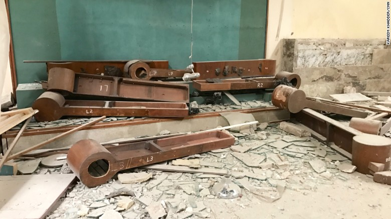 Wooden display stands lie on the floor of the Mosul Museum. The museum artifacts were looted and destroyed by ISIS in February 2015. Officials say ISIS smuggled some of the artifacts out of Iraq to sell on the black market.