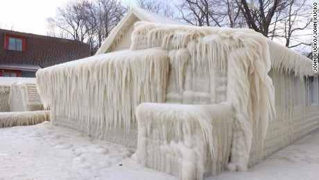 Home frozen solid on shore of Lake Ontario in upstate NY