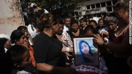 Relatives and friends attend the funeral of 17-year-old Siona Hernandez, who died in a fire at a state-run shelter, at the general cemetery in Guatemala City on March 10, 2017.  Guatemala recoiled in anger and shock at the deaths of at least 36 teenage girls in a fire -19 died immediately and the other 17 died in hospital of horrific burns-  at a government-run shelter where staff has been accused of sexual abuse and other mistreatment. All the victims were aged between 14 and 17. / AFP PHOTO / JOHAN ORDONEZ        (Photo credit should read JOHAN ORDONEZ/AFP/Getty Images)