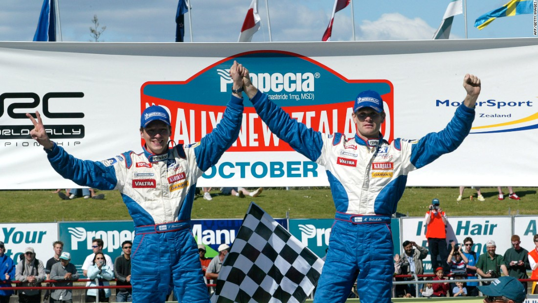 Marcus Gronholm (right) and co-driver Timo Rautiainen celebrate winning the 2002 World Rally Championship following the final stage of the Rally of New Zealand.