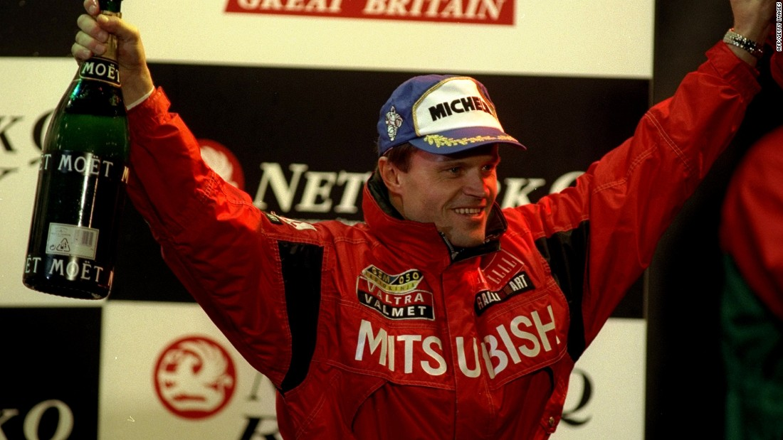 Makinen celebrates being crowned world rally champion in 1998.