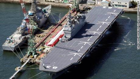 YOKOHAMA, JAPAN - MARCH 25:  (CHINA OUT, SOUTH KOREA OUT) In this aerial image, the Izumo helicopter carrier awaits its official launch at a port on March 25, 2015 in Yokohama, Kanagawa, Japan. The Maritime Self-Defense Force officially commissioned the largest ship in its fleet, a massive destroyer that gives it the capability of detecting highly advanced Chinese submarines. The Izumo measures 248 meters in length, has five landing spots on its flight deck for reconnaissance helicopters that can locate submarines. It can carry up to nine helicopters at a time, five more than the Hyuga. The Izumo joined the MSDF's Escort Flotilla 1, which is based in Yokosuka, Kanagawa Prefecture.  (Photo by The Asahi Shimbun via Getty Images)