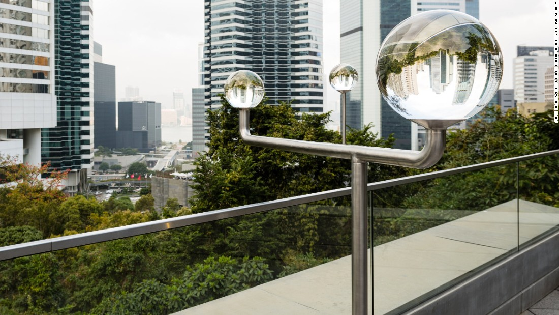 Chloe Cheuk's outdoor sculpture creates a lens-like device from three crystal balls, capable of being swiveled and rearranged to distort and flip different parts of the city skyline. One can swing the contraption toward the harbor — or toward Hong Kong's government building itself.