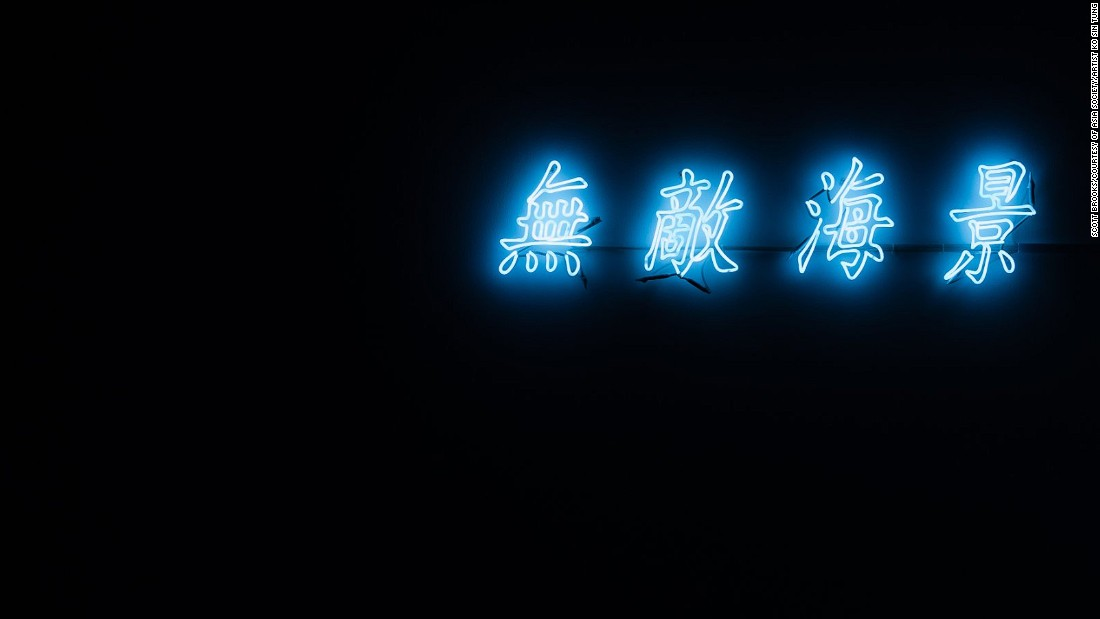 "Ko Sin Tung's installation spells a common real estate catchphrase - ""spectacular seaview"" using Hong Kong's iconic neon lights. The rueful joke: the installation is mounted in the corner of a drab white windowless space."