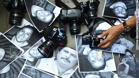 Protesters show photos of journalists killed over the years in Veracruz, Mexico.