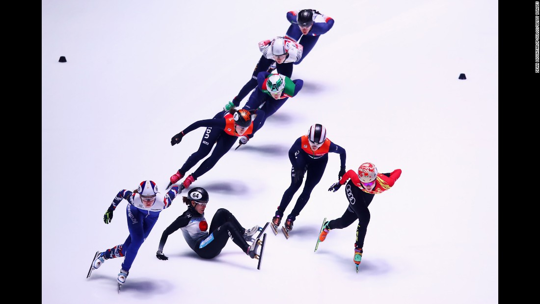 Sumire Kikuchi, a short-track speedskater from Japan, falls during a 1,500-meter race at the World Championships on Saturday, March 11.<br />