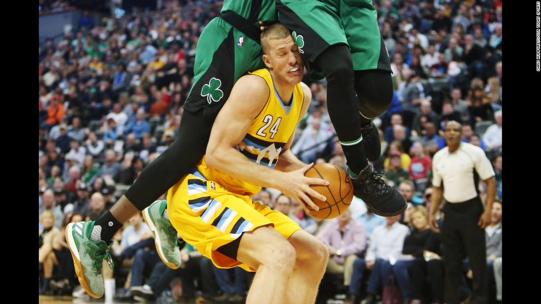 Denver center Mason Plumlee is fouled during an NBA game against Boston on Friday, March 10.