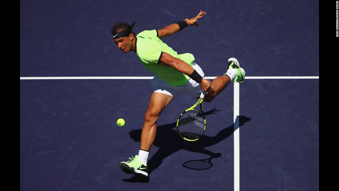 Rafael Nadal plays a backhand volley during a second-round match at the BNP Paribas Open, a tournament in Indian Wells, California, on Sunday, March 12. Nadal defeated Guido Pella in straight sets.