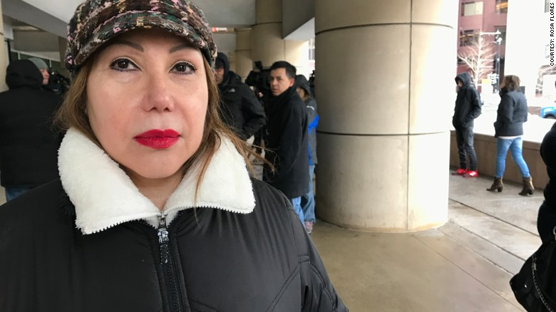 Esperanza Perez waits outside ICE for news about her son's case.