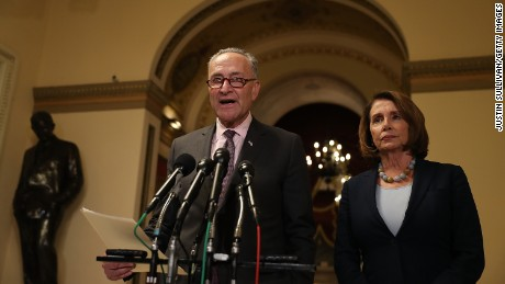 Senate Minority Leader Charles Schumer (D-NY) speaks as House Minority Leader Nancy Pelosi (D-CA) looks on during a news conference at the U.S. Capitol on March 13, 2017 in Washington, DC.  House Minority Leader Nancy Pelosi and Senate Minority Leader Charles Schumer (D-NY) held a news conference to react to the CBO report on the proposed American Health Care Act.