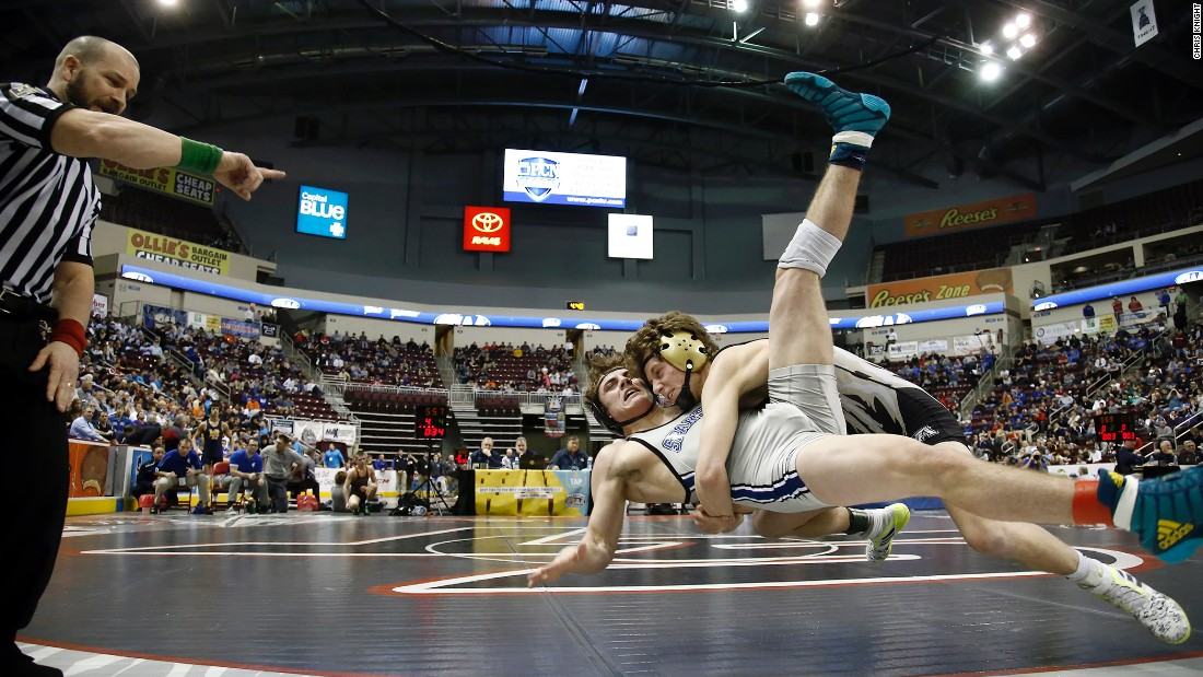 Belle Vernon's Tyler Seliga, right, wrestles Garden Spot's Connor Finkey during a high school match in Hershey, Pennsylvania, on Thursday, March 9.