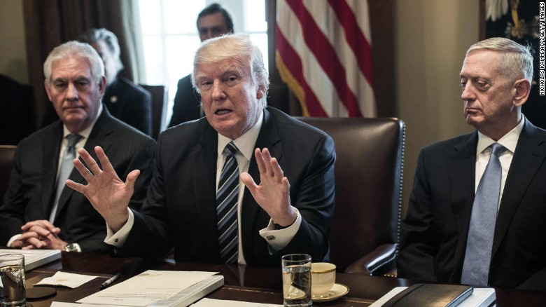 President Donald Trump speaks to the press with Secretary of State Rex Tillerson and Defense Secretary James Mattis at the White House on March 13, 2017.