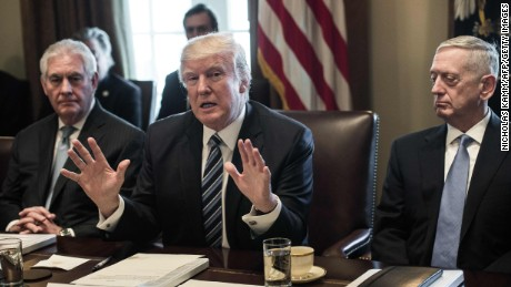 US President Donald Trump speaks to the press with Secretary of State Rex Tillerson (L) and Defense Secretary James Mattis (R) as he meets with his Cabinet in the Cabinet Room at the White House in Washington, DC, on March 13, 2017.