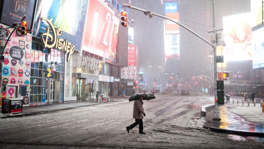 A person crosses the street in New York's Times Square on March 14.