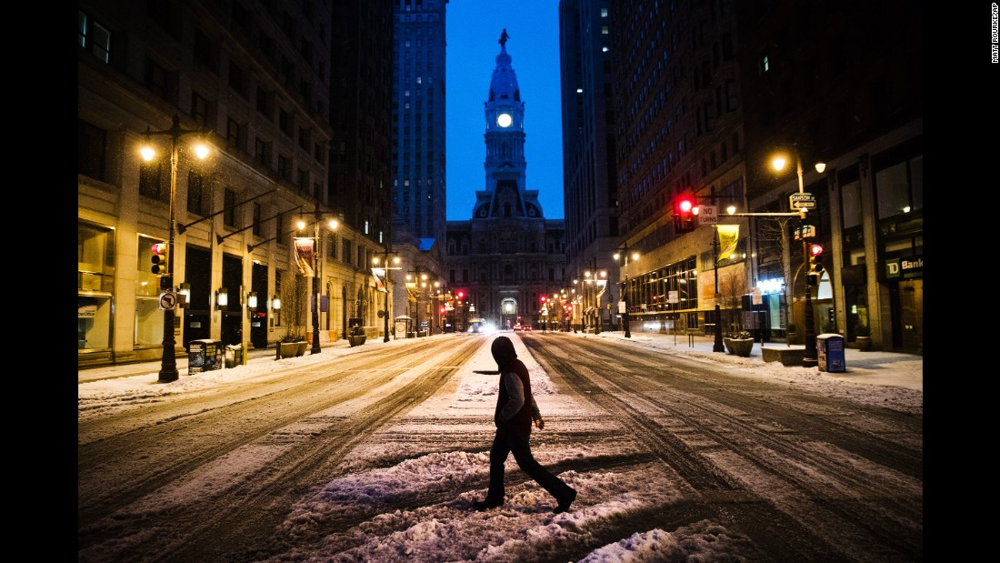A man crosses South Broad Street in Philadelphia on March 14.