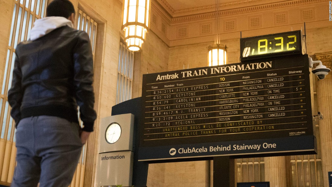 A man looks at train cancellations in Philadelphia on March 14.