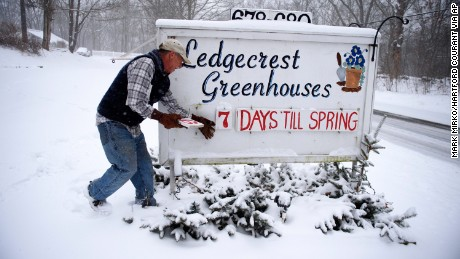 Paul Hammer of Ledgecrest Greenhouses changes the numbers of days remaining until spring on a sign in front of his nursery in Mansfield, Connecticut, on Tuesday, March 14.
