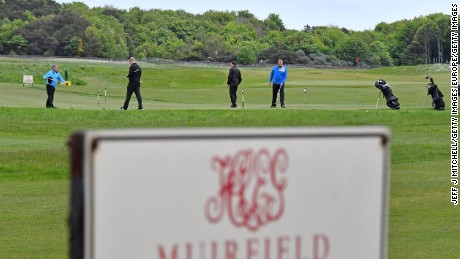 Golfers play at Muirfield Golf Club in Gullane,Scotland.