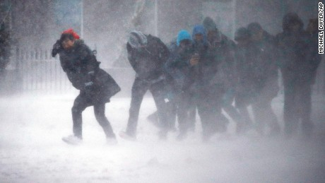 People struggle to walk in the blowing snow in Boston on March 14.