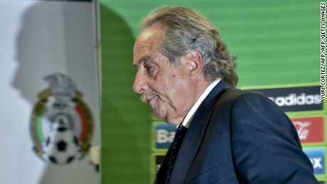 The president of the Mexican Football Federation Decio de Maria Serrano leaves after announcing the dismissal of Mexico's national football team coach Miguel Herrera during a press conference on July 28, 2015 in Mexico City.  Mexico's coach Miguel Herrera was sacked on Tuesday following allegations of an assault against a television journalist, just two days after guiding them to their seventh Gold Cup trophy in the United States.  AFP PHOTO/ Yuri CORTEZ        (Photo credit should read YURI CORTEZ/AFP/Getty Images)