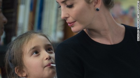 Ivanka Trump looks at her daughter Arabella as President Donald Trump meets with parents and teachers at Saint Andrew Catholic School in Orlando, Florida, on March 3, 2017.