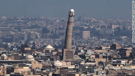 A general view shows the leaning minaret of the Great Mosque of al-Nuri in Mosul, on March 10, 2017, as Iraqi forces shell enemy positions during an offensive to retake the western parts of the city from the jihadists.