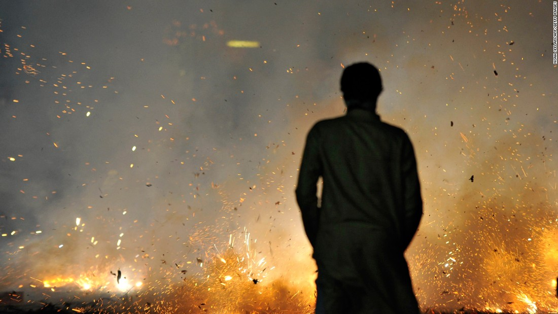 <strong>Diwali, India --</strong> In honor of the festival of lights, many communities in India set off a series of powerful pyrotechnics. But instead of typical tube-like fireworks, these explosives shoot out of holes in the ground for a big bang.