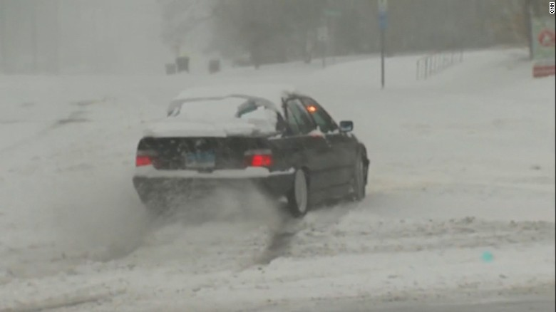 Winter storm pummels millions, grounds flights