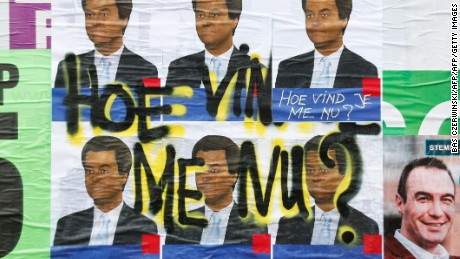 "A photo shows posters of Dutch politician and leader of the Party for Freedom (PVV), Geert Wilders with the inscription ""How you like me now?"",  a reference to the work of American artist David Hammons' How ya like me now? "", on March 9, 2017 in Rotterdam.  General elections are scheduled to be held in the Netherlands on March 15, 2017.  / AFP PHOTO / ANP / Bas Czerwinski / Netherlands OUT        (Photo credit should read BAS CZERWINSKI/AFP/Getty Images)"