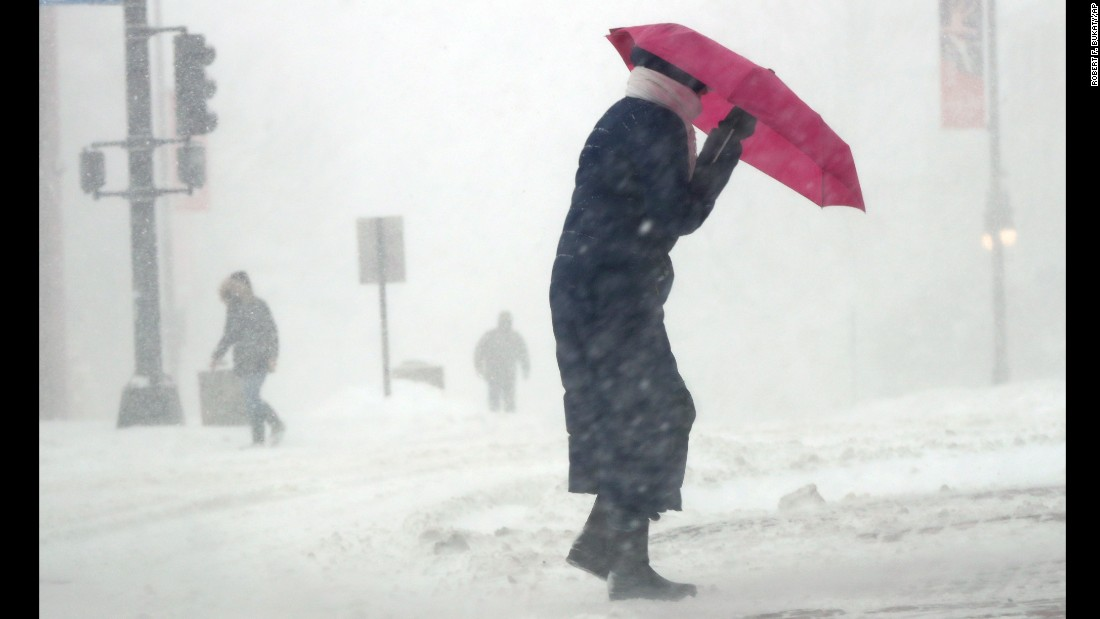 Cherie Burke contends with blowing snow in Portland, Maine, on March 14.