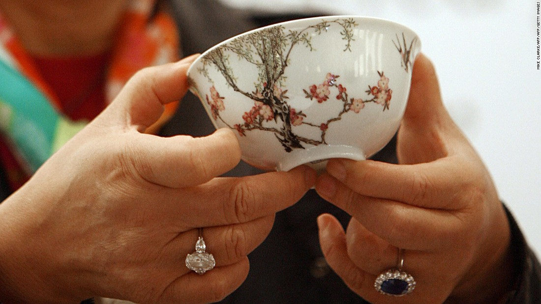 "Chinese ceramics collector Alice Cheng holds an 18th century Chinese famille-rose ""swallows bowl"" she purchased at a Christie's auction in Hong Kong in 2006. The tiny bowl sold for $19.4 million (HK$151.3 million), breaking the record at that time for a piece of Chinese ceramic art at auction."