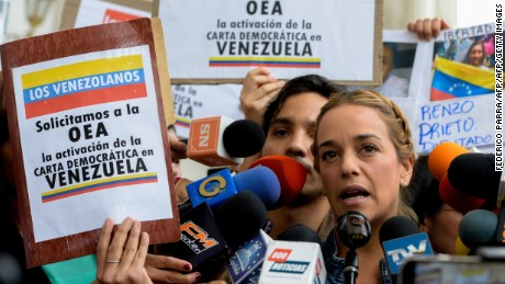 Lilian Tintori (L), wife of jailed Venezuelan opposition leader Leopoldo Lopez submits to the president of the National Assembly, Julio Borges (R) a request for the Organization of American States (OAS) for the activation of the Inter-American Democratic Charter, at the National Assembly in Caracas on March 7, 2017. / AFP PHOTO / FEDERICO PARRA        (Photo credit should read FEDERICO PARRA/AFP/Getty Images)