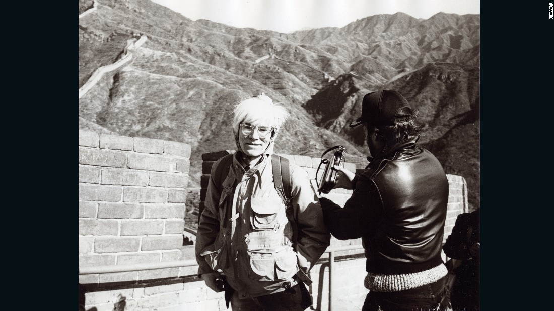Warhol visited the Great Wall of China during his three-day trip to Beijing. According to photographer Christopher Makos, who accompanied Warhol on the trip, the man in the leather jacket is probably documentary maker Lee Caplin.