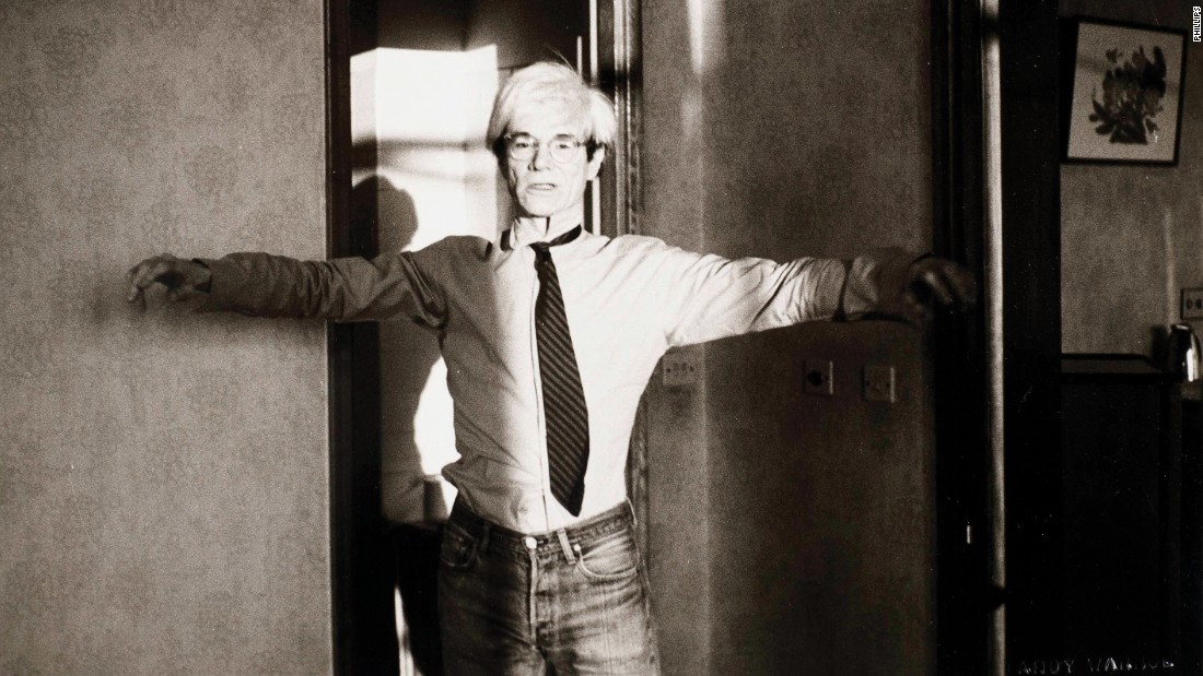 Here Warhol is mimicking a Tai Chi pose, likely in Beijing's Peking Hotel. The late pop artist allegedly wore the same outfit every day during the trip.